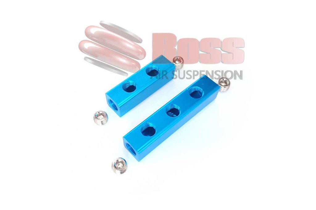 Air manifold block boss suspension